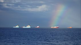 Offshore supply boat and rainbow in the Aberdeen Harbour stock video footage