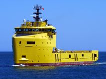 Offshore Supply Ship 15b. Offshore Supply Ship underway at sea over blue Stock Photography