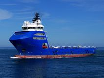 Offshore Supply Ship 15c. Offshore Supply Ship underway at sea over blue sky Stock Images