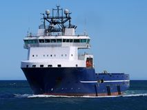 Offshore Supply Ship 15e. Offshore Supply Ship underway at sea over blue sky Stock Images