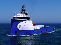 Offshore Supply Ship 14a. Offshore Supply Ship underway at sea over blue sky and sea Stock Photos