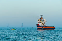 Offshore supply vessel sailing for the service. Offshore supply boat sailing out from Abu Qir harbour (Egypt) for supply service Royalty Free Stock Photos