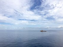 Offshore supply vessel on standby. In a calm waters Stock Photography
