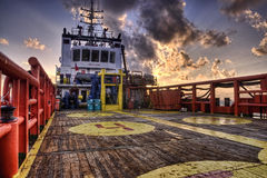 Offshore vessel at deck. View deck of offshore vessel during morning with cloud and sun ray in HDR stock images