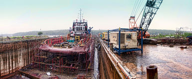 Offshore vessel at drydock during raining. OSV vessel at evening during rain at dry docking royalty free stock photography