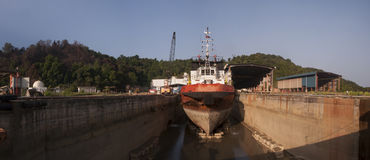 Offshore vessel at drydock. Rust remove from ship hull during dry dock stock image