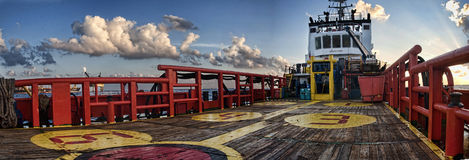 Offshore vessel view from deck during sunrise Royalty Free Stock Images