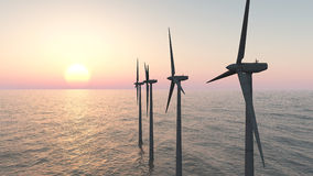 Offshore wind farm at sunset Stock Photos