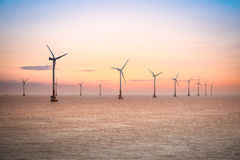 Offshore wind farm in sunset Stock Images