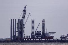 Offshore wind farm turbine construction. Supply vessel ship. Stock Photography