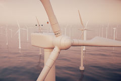 Offshore wind farm turbines caught in sunset sky. Beautiful contrast with the blue sea. ecological concept. 3d rendering stock illustration