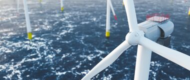 Free Offshore Wind Power And Energy Farm With Many Wind Turbines On The Ocean Stock Image - 198284001