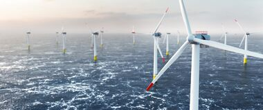 Free Offshore Wind Power And Energy Farm With Many Wind Turbines On The Ocean Stock Photos - 217644693