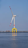 Offshore wind turbine. With yellow base royalty free stock images
