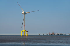 Offshore wind turbine. With yellow base stock photo