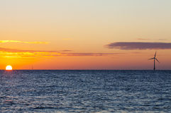 Offshore wind turbine at sunrise Stock Photo