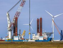 Offshore wind turbine supply vessel. Anchored and loading in port of Eemshaven, Netherlands Stock Photos