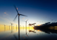 Offshore wind turbines at daybreak Royalty Free Stock Image
