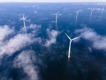 Free Offshore Windmill Park With Clouds And A Blue Sky, Windmill Park In The Ocean Drone Aerial View With Wind Turbine Royalty Free Stock Photography - 220754677