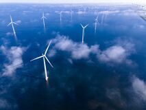 Free Offshore Windmill Park With Clouds And A Blue Sky, Windmill Park In The Ocean Drone Aerial View With Wind Turbine Royalty Free Stock Images - 220755329