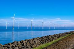 Free Offshore Windmill Park With Clouds And A Blue Sky, Windmill Park In The Ocean Drone Aerial View With Wind Turbine Stock Image - 220757401
