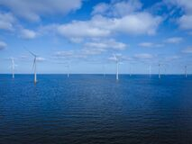 Free Offshore Windmill Park With Clouds And A Blue Sky, Windmill Park In The Ocean Drone Aerial View With Wind Turbine Stock Image - 221115211