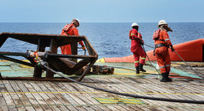 Offshore worker on deck. Ship crew working on deck during anchor job at sea stock photo