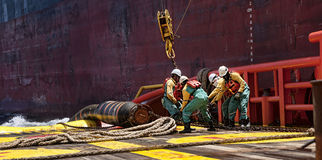 Offshore worker doing anchor handling job Royalty Free Stock Image