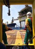 Offshore worker at south angsi lifting operation. Offshore worker standby waiting instruction from oil platform to received cargo at South Angsi Oilfeild royalty free stock photos