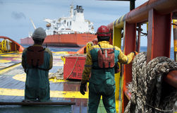 Offshore working on deck. Deck crew standby on deck before ship along side with FPSO floating storage tanker royalty free stock photos