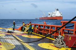 Offshore working on deck. Deck crew standby on deck during static tow operation with crude oil tanker at sea royalty free stock photography