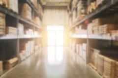 Offuschi lo stoccaggio di riserva del prodotto di inventario del magazzino per spedire fotografia stock libera da diritti