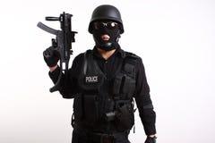 Oficial de policía del GOLPE VIOLENTO Fotografía de archivo