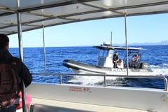 Oficial de policía en el barco de la gasolina Imagen de archivo libre de regalías