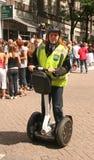 Oficial de policía en Segway Foto de archivo libre de regalías