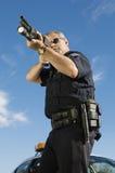 Oficial de policía With Gun Imagen de archivo libre de regalías