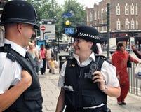 Oficiales de policía de Londres en el golpe imagen de archivo libre de regalías