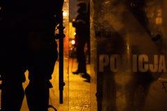 Oficiales de policía en la aplicación de ley de la protesta de la calle Fotografía de archivo libre de regalías