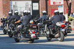 Oficiales de policía en la ejecución de las motocicletas Fotos de archivo libres de regalías