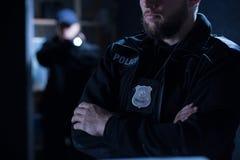 Oficiales de policía en la intervención Fotografía de archivo