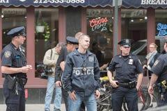 Oficiales de policía en las calles Fotografía de archivo libre de regalías