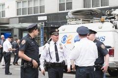 Oficiales de policía en las calles Imágenes de archivo libres de regalías