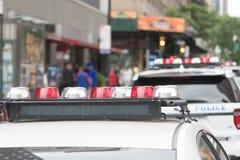 Oficiales de policía en las calles Imagen de archivo libre de regalías