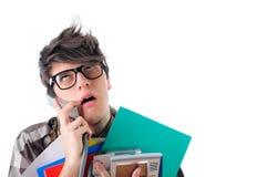 Oficinista aburrido en el teléfono, aislado en blanco imagen de archivo libre de regalías