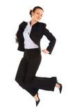 Oficinista de sexo femenino de salto joven Imagenes de archivo