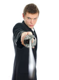 Oficinista de sexo masculino con la espada. Foto de archivo libre de regalías
