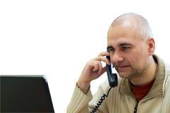 Oficinista en el teléfono imagen de archivo libre de regalías