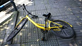 OFO bycicle fall on the pavement. A net-bycicle OFO bycicle falls on the walk street. Taken in Chongqing, China Stock Image