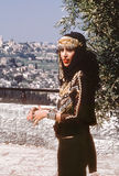 Ofra Haza. Israeli mega-star singer/recording artist, Ofra Haza, posing in traditional Yemenite attire, with a scenic backdrop of Jerusalem, was her country`s Royalty Free Stock Photo