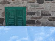 Often a blanket of snow covers a window royalty free stock image